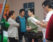 Working on a scene with his co-stars Ana Guillen Feleo and Alwyn Uytingco, and director Mac Alejandre,