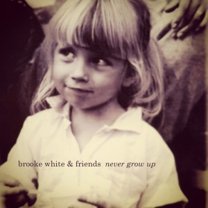NEVER GROW UP COVER ARTsm